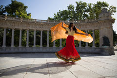 Free Young Beautiful Traditional Indian Woman Dancing Outdoors Stock Photography - 75178452