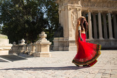 Young beautiful traditional indian woman dancing outdoors Royalty Free Stock Image