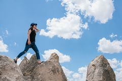 Young beautiful travel girl on top of a hill in Cappadocia, Turkey. Travel, success, freedom, achievement. She goes. Stock Image