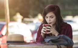 Young beautiful traveler enjoying a coffee at street cafe Stock Photos