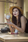 Young beautiful traveler enjoying a coffee at street cafe Stock Images