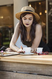 Young beautiful traveler enjoying a coffee at street cafe Stock Photography