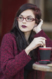 Young beautiful traveler enjoying a coffee at street cafe Royalty Free Stock Photography
