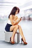 Traveler in airport with phone Stock Photos