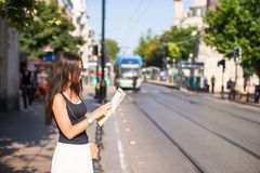 Young beautiful traveling woman with map of city Royalty Free Stock Photography