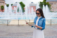 Young beautiful traveling woman with map of city Stock Photo