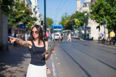 Young beautiful traveling woman with map in the Stock Image