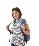 Young beautiful and trendy latin student girl carrying backpack smiling happy and confident Royalty Free Stock Images