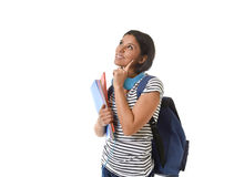 Young beautiful and trendy latin student girl holding notepad folder and book carrying backpack thinking happy Stock Image