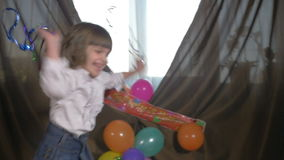 Young beautiful twin sisters dancing at a birthday party with confetti, slow motion. Young beautiful twin sisters dancing at a birthday party with confetti in stock video