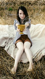 Young beautiful unusual girl illustrates conceptual idea in fiel Royalty Free Stock Photography