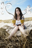 Young beautiful unusual girl illustrates conceptual idea in fiel Stock Image