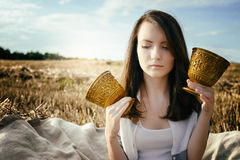 Young beautiful unusual girl illustrates conceptual idea in fiel Stock Images