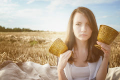 Young beautiful unusual girl illustrates conceptual idea in fiel Stock Photos