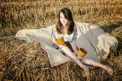 Young beautiful unusual girl illustrates conceptual idea in fiel Royalty Free Stock Image
