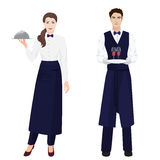 Young beautiful waitress and handsome waiter at restaurant . Royalty Free Stock Photography