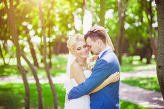 Young beautiful wedding couple in the park Royalty Free Stock Photo