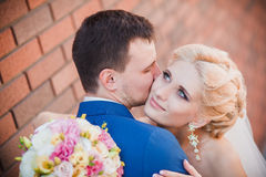 Young beautiful wedding couple in the park Royalty Free Stock Image