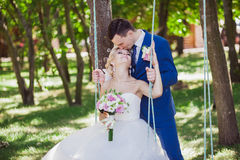 Young beautiful wedding couple in the park Royalty Free Stock Images