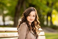 Young beautiful white woman with curly brown hair, stock photo
