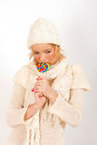 Young beautiful winter girl with lollipop candy Stock Photo