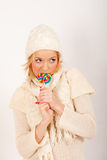 Young beautiful winter girl with lollipop candy Stock Photos