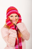 Young beautiful winter girl with pink gloves Royalty Free Stock Image