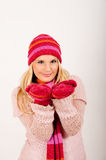 Young beautiful winter girl with pink gloves Stock Images