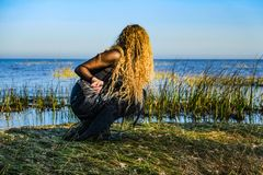 The witch on the sea on Halloween Stock Photography