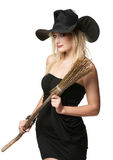 The  young beautiful witch with a broom Stock Images