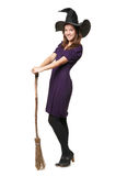 The  young beautiful witch with a broom and hat Stock Photos