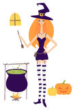 Young beautiful witch cooking Royalty Free Stock Image