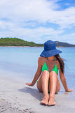 Young beautiful woma relaxing at white sand Stock Images