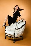 Young beautiful woman. And antique armchair Stock Images