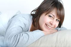 Young beautiful woman. Smiling in the bed stock photos