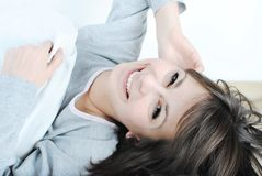 Young beautiful woman. Smiling in the bed royalty free stock image