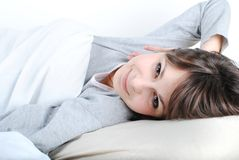Young beautiful woman. Smiling in the bed stock images