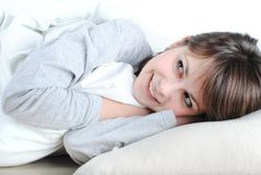 Young beautiful woman. Smiling in the bed stock image