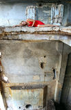 Young beautiful woman in abandoned construction Royalty Free Stock Image