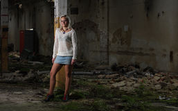 Young beautiful woman in an abandoned factory