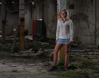 Young beautiful woman in an abandoned factory Stock Photography