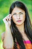 Young beautiful woman adjusts Stock Photo