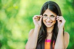 Young beautiful woman adjusts Royalty Free Stock Photos