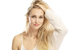 Young beautiful woman adjusts her hand to long hair stock images