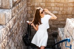 Young beautiful woman against a stone wall Royalty Free Stock Images
