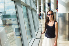 Young beautiful woman in airport while waiting for Stock Images