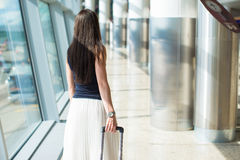 Young beautiful woman in airport while waiting for Royalty Free Stock Photography