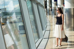Young beautiful woman in airport while waiting for Royalty Free Stock Image