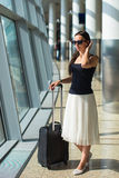 Young beautiful woman in airport while waiting for Royalty Free Stock Photos