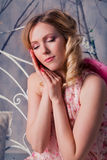 Young beautiful woman in angel costume with pink wings Royalty Free Stock Images